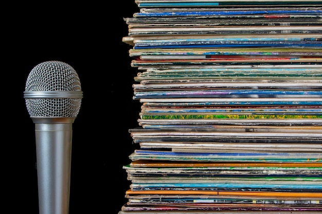 A stack of old records and microphone Premium Photo