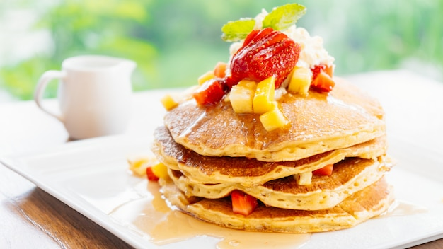Stack of pancake with strawberry on top Free Photo