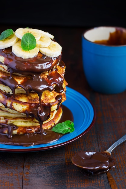Stack of pancakes in the streaked chocolate Premium Photo