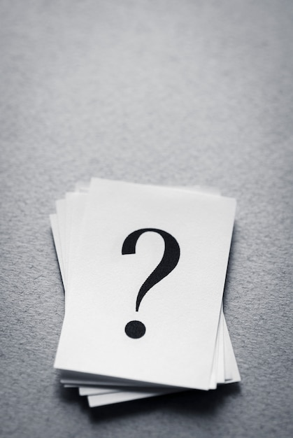 Stack of paper cards with a printed question mark Premium Photo