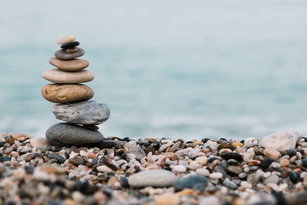 Stack of pebble stones on ocean. peaceful and calm concept Premium Photo