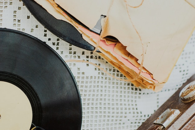 Stack of scratched dusty old vinyl records tied with rope Premium Photo