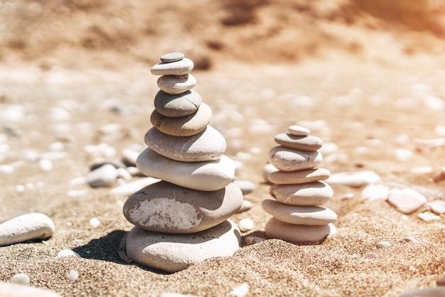Stack of sea stones on the beach. Premium Photo
