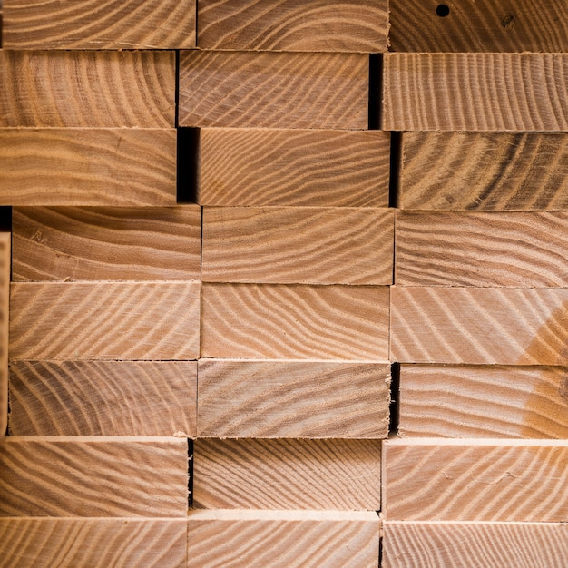 Stack of square wood planks for furniture materials Free Photo