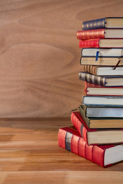 Stack of various books on a table Free Photo