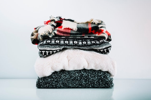 Stack of warm woolen clothes Free Photo