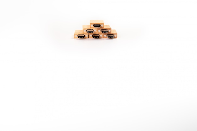 Stack of wooden pendrive memory usb isolated on white background. Premium Photo