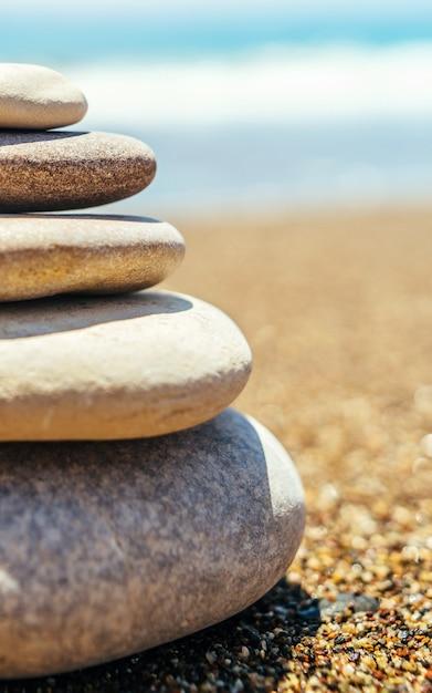 Stack of zen stones on the beach near sea Premium Photo