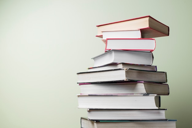 Stacked books with different colors Free Photo