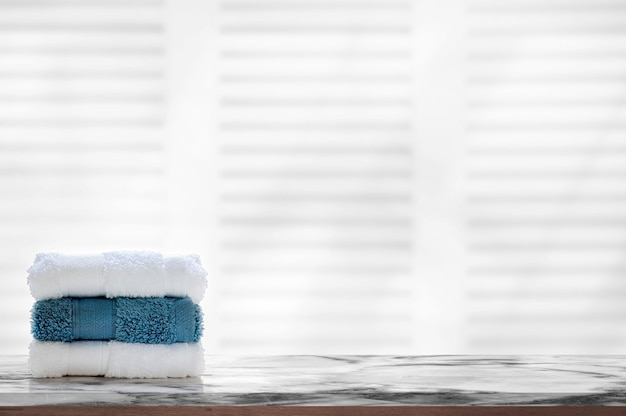 Stacked clean spa towels on marble top table. Premium Photo