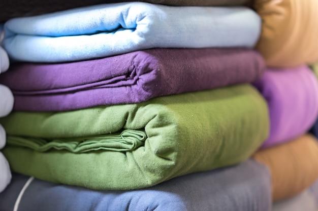 Stacked cotton folded on a shelf Premium Photo
