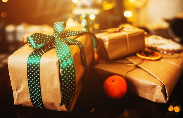 Stacked gifts with green bows and an orange Free Photo