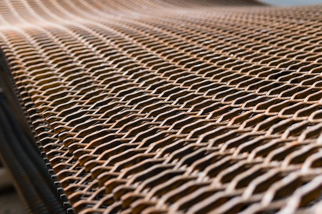 Stacked heavily rusty metal wire grid on a construction site Premium Photo