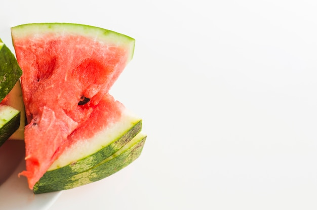 Stacked of juicy watermelon triangular slices isolated on white background Free Photo