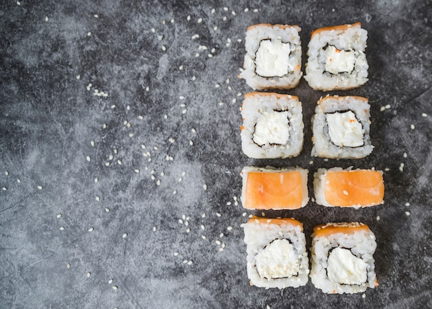 Stacked sushi with seeds and copy-space Free Photo