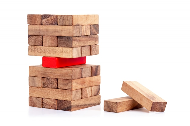 Stacked wooden block and red block  concept of leadership
