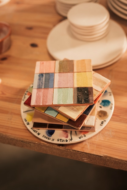 Stacked of wooden ceramic palette on table Free Photo