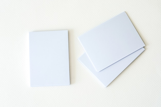 Stacking of mockup empty white business card  on a white paper background Premium Photo