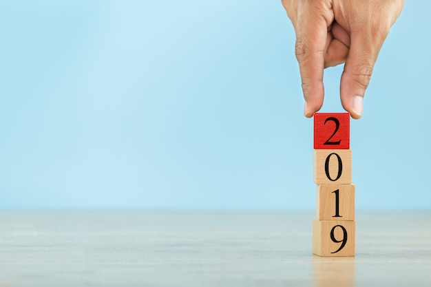 Stacking wooden blocks into steps,concept 2019 of business growth success Premium Photo