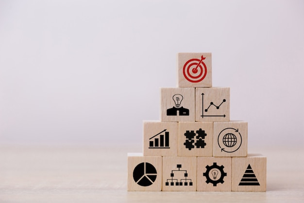 Stacking wooden blocks into steps,concept of business growth success Premium Photo
