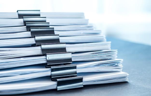 Stacks documents files with black clip Premium Photo