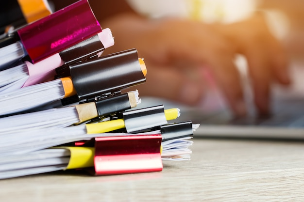 Stacks of papers documents files information business report papers with color clips paper Premium Photo