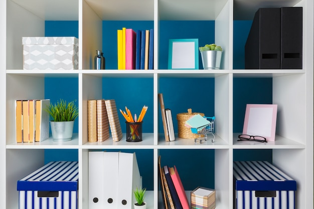 Stacks of supplies and paperwork in the office and bookshelves Premium Photo