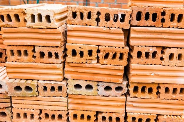 Stacks of terra cotta bricks Premium Photo