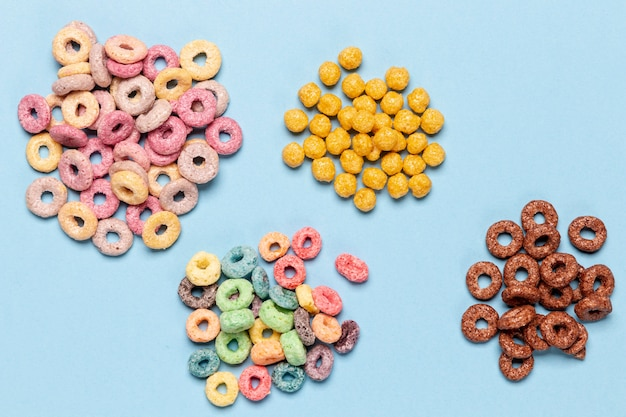 Stacks of various cereal loops top view Free Photo
