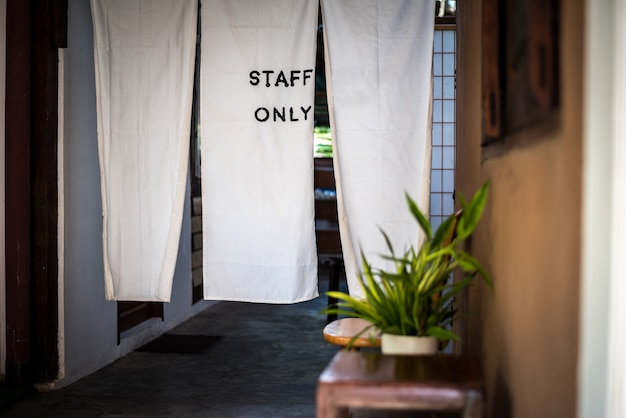 Staff only sign, at the door made from white fabric to keeping confidential Premium Photo