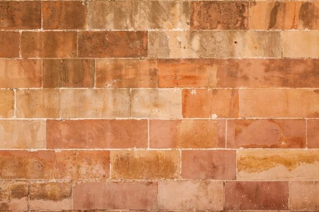 Struttura di muro di mattoni macchiati Foto Gratuite