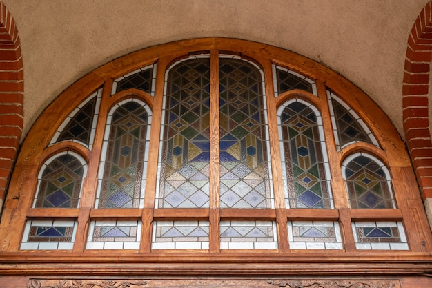 Stained glass window in old cathedral or church. Premium Photo