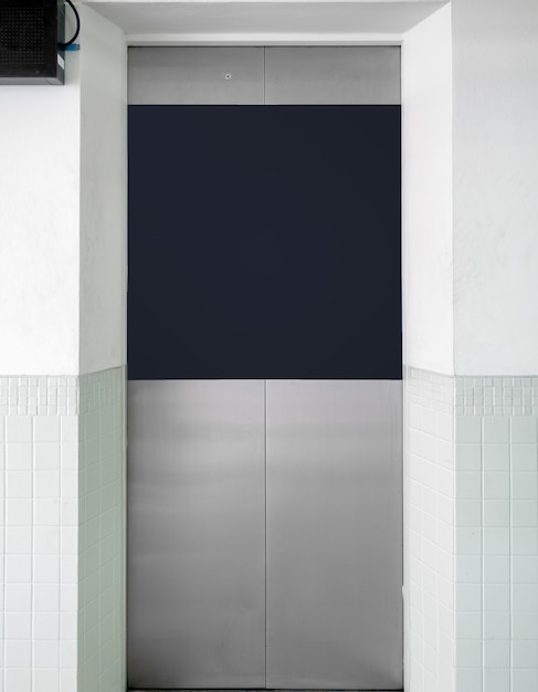Stainless elevator gate with banner Premium Photo