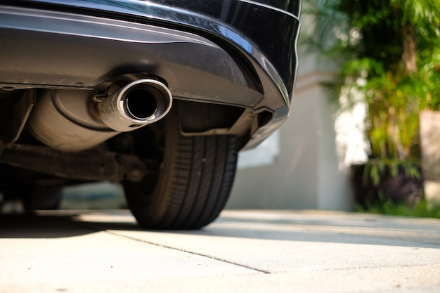 Stainless exhaust pipe at the bottom of car. Premium Photo