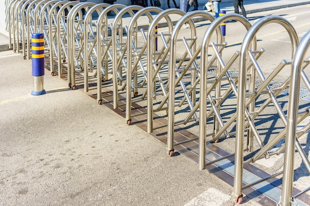 Stainless steel panel barrier with wheel on cement ground floor Premium Photo