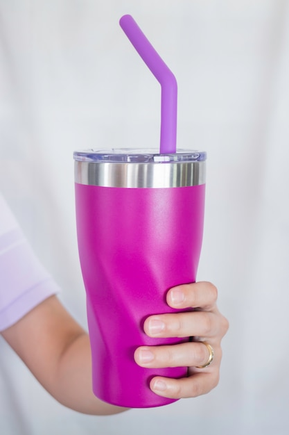 Stainless steel thermos mugs and silicone straw for reusable set Premium Photo