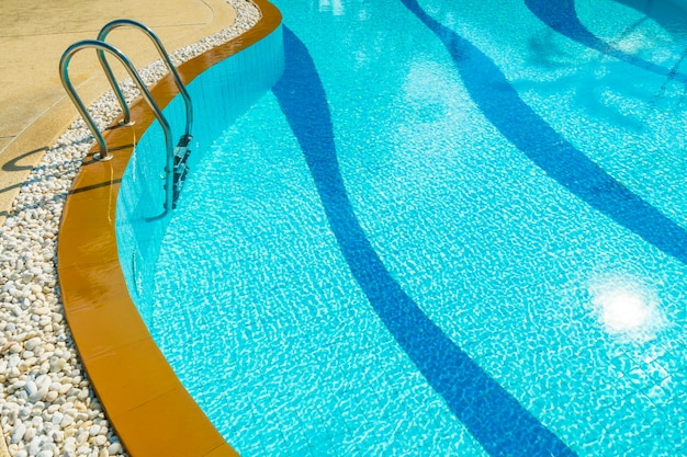 Stair around swimming pool in hotel and resort Free Photo