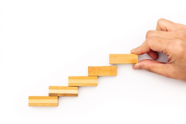 Staircase step to success. successful business concept. wooden step Premium Photo