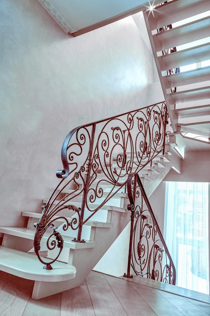 decorative wrought iron indoor stair railings decorative.htm staircase with wrought iron railing in an empty house premium photo  wrought iron railing in an empty house