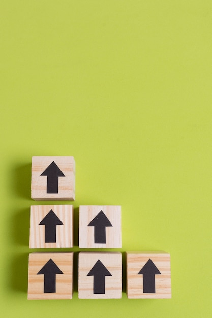 Stairs made from wooden cubes with arrows Premium Photo