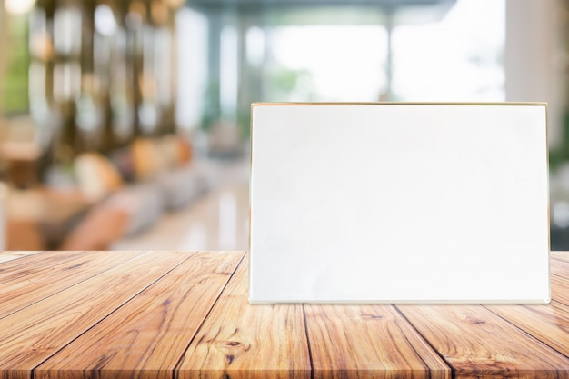 Stand mock up menu frame card or noticeboard on blurred background interior Premium Photo