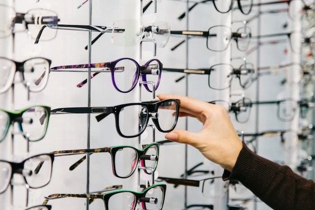 Stand with glasses in the store of optics. Premium Photo