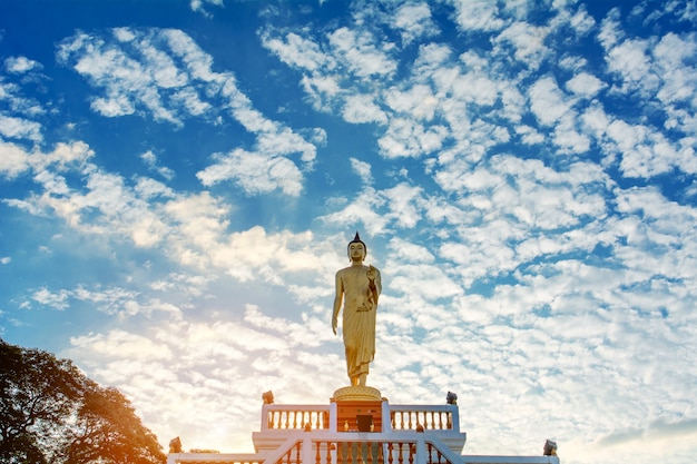 Standing buddha image and the blue sky, religious concepts Premium Photo