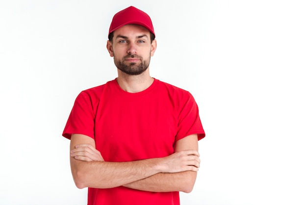 Standing courier man having his arms crossed Free Photo