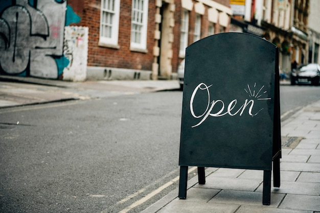 Standing frame of an open sign for business Free Photo