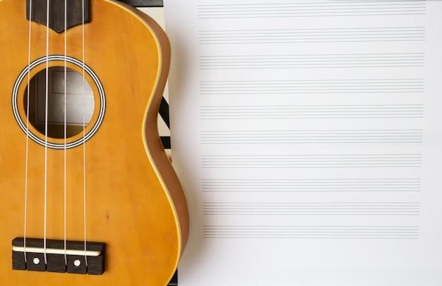 Standing music sheet and ukulele Premium Photo