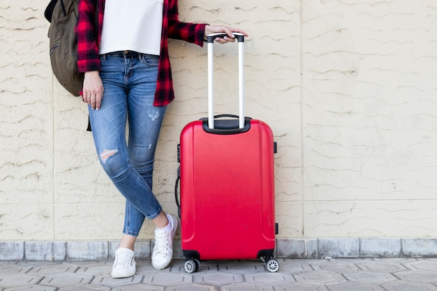 Standing traveller woman with luggage Premium Photo