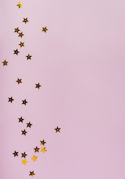Star golden sequins with copy space Free Photo