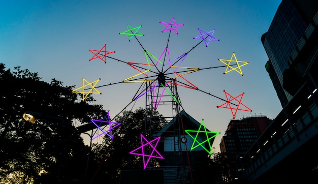 Star shaped neon windmill in a festival Free Photo