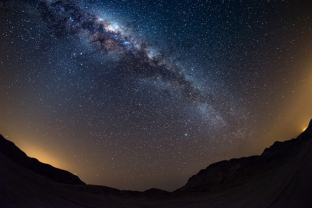 Starry sky and milky way arch, with details of its colorful core, outstandingly bright, captured from the namib desert in namibia. Premium Photo
